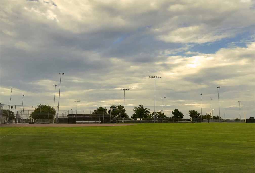 baseball field with clouds